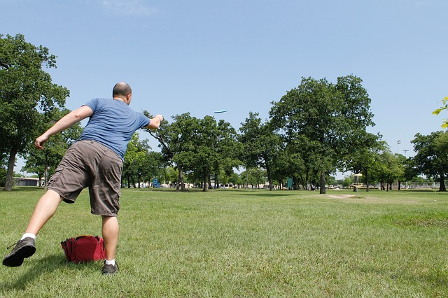 Man tossing a disc golf disc